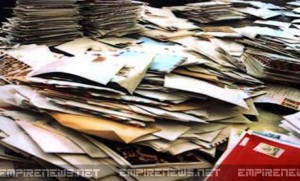 Mailman Arrested After 3 Tons of Undelivered Mail Found in His Backyard